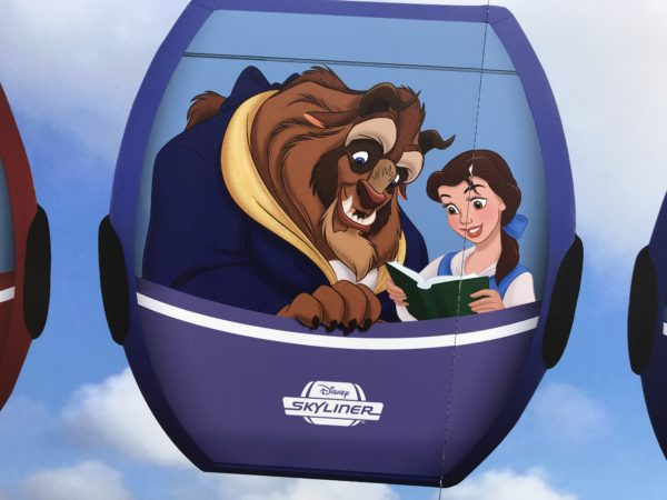 Beast and Belle appear in this concept art of one of the gondola cabins.