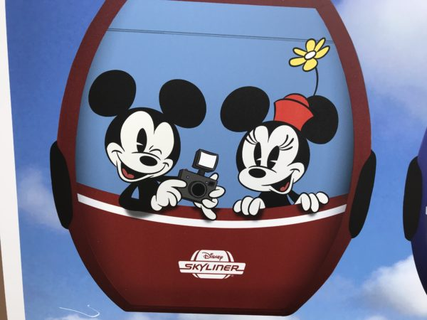 Mickey and Minnie are taking a picture in this gondola cabin.