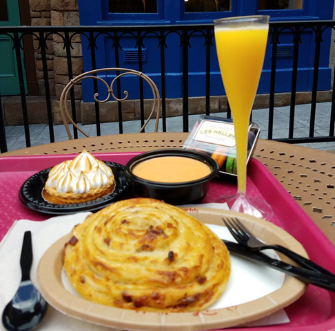 Eating alone at Disney doesn't have to be lonely. Just grab a spot outside and enjoy looking at the beautiful scenery and people watching.