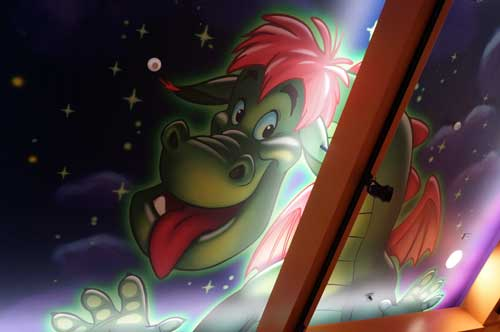 Ceiling mural of Pete's Dragon in the World of Disney Store.
