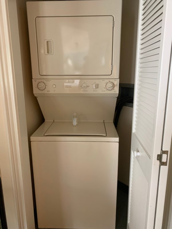 The laundry is located just outside of the master bedroom.
