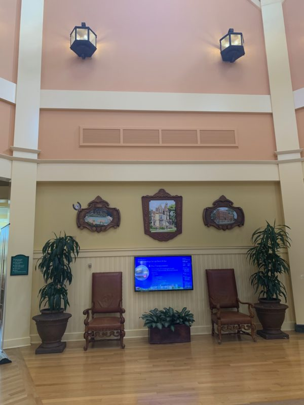 This tv in the lobby displays useful information for guests including park hours and recreational activities.