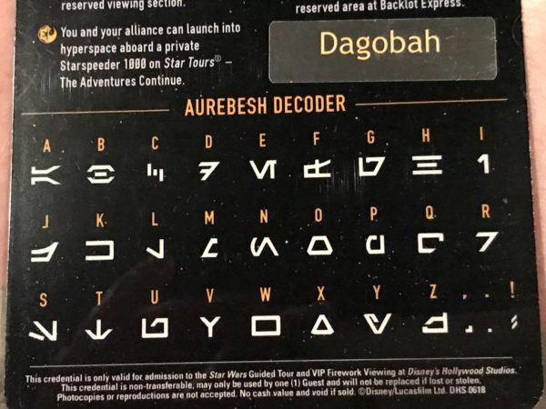 Use the Aurebesh decoder on the back of your lanyard.