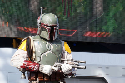 Boba Fett, the bounty hunter, keeps an eye on the crowd.