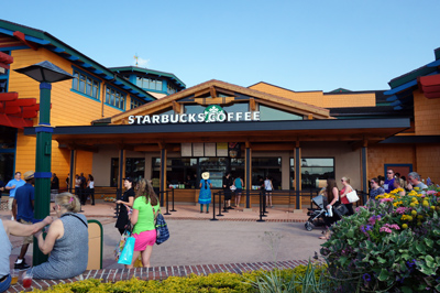 The Starbucks is located between two entrances to the World of Disney store.