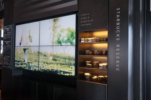 Starbucks Reserve location features a video wall.
