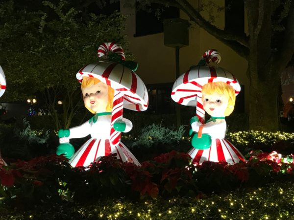 These cute dolls hold candy cane umbrellas!
