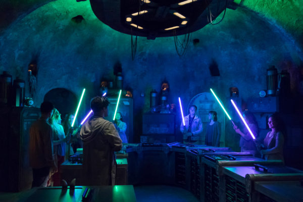 Build your own lightsaber at Savi's Workshop with the help of a Gatherer. Photo credits (C) Disney Enterprises, Inc. All Rights Reserved