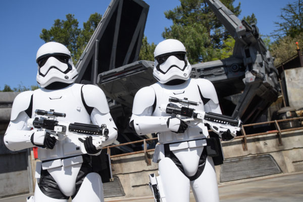 First Order Stormtroopers guarding a docked ship. Photo credits (C) Disney Enterprises, Inc. All Rights Reserved