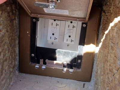The outlets are hidden behind the door - and are free to use.