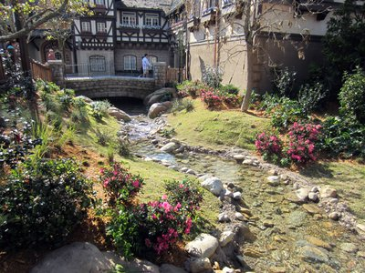 A flowing stream makes the area peaceful.