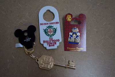 The gift pack includes a key chain, magnet, and Disney Trading pin.