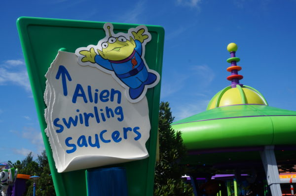 The toys ripped some paper and used an alien sticker to secure this sign for Alien Swirling Saucers!
