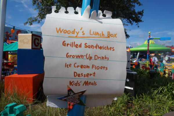 They found some notebook paper to write the menu for Woody's Lunch Box and stuck it to a colored pencil.