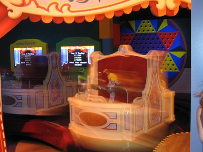 Spinning cars are part of the fun at Toy Story Mania.