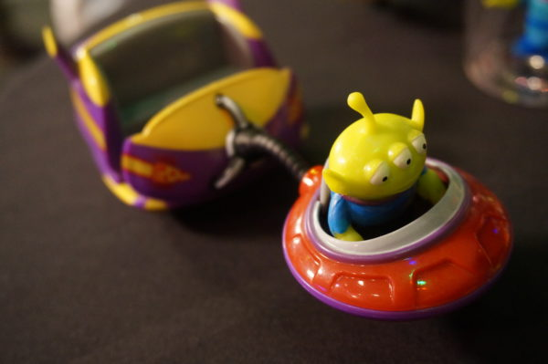 This alien toy looks like the Alien Swirling Saucers ride vehicles.