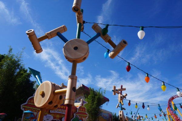 All of Toy Story Land is built out of classic toys like this Tinker Toy tower that supports the Christmas lights!