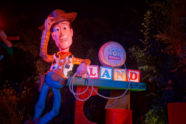 Woody welcomes you to Toy Story Land at night!