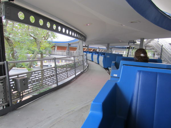 The Disney World TTA has open-air cars with a covered track.