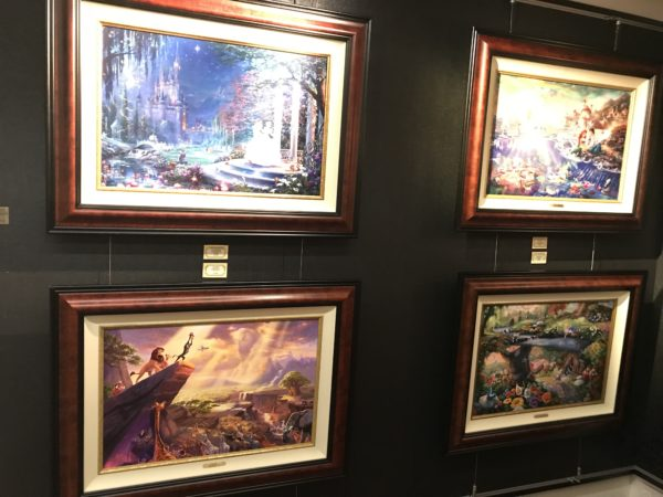 Artwork is hung in traditional gallery style.