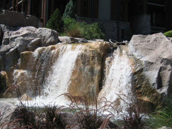 The Disney Resort Hotels offer a nice respite from the parks like this beautiful waterfall at Disney's Wilderness Lodge.