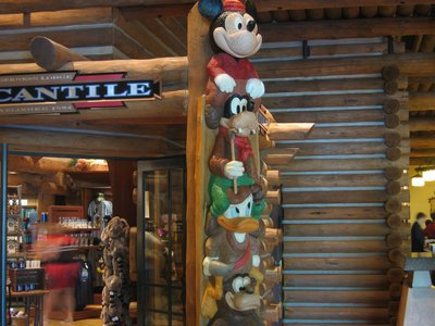 The pole near the gift shop features Disney characters.