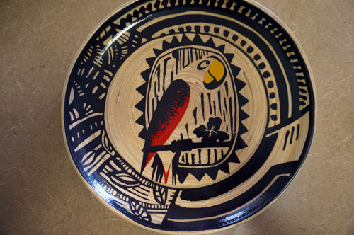 Two plates feature this parrot design.