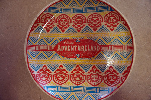 Two plates feature the classic Adventureland logo.