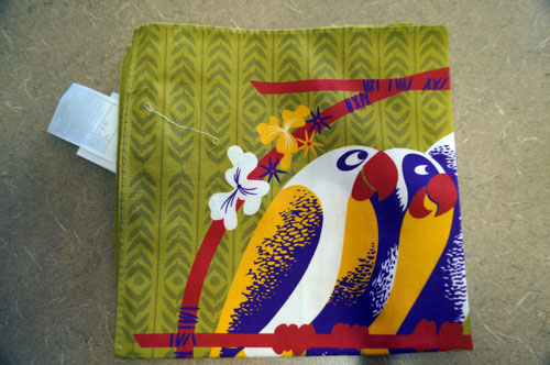 One colorful parrot napkin.