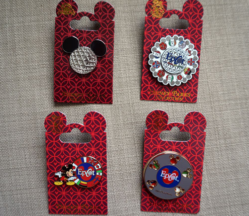 One lucky winner will get all four of these Epcot pins.