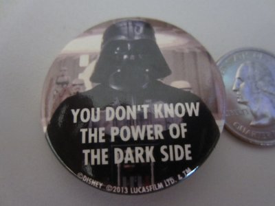 You can win this Darth Vader pin.  It's small (see quarter in background) but big on fun.