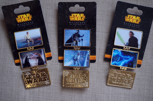 Three panel pins celebrate A New Hope, The Empire Strikes Back, and Return of the Jedi.