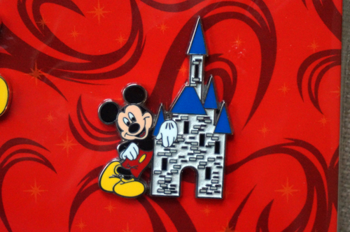 Mickey Mouse poses with a cartooned Cinderella Castle.