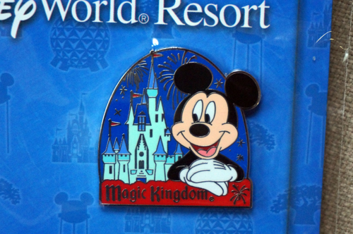 This classic pin features Mickey, Cinderella Castle, and the Magic Kingdom logo.