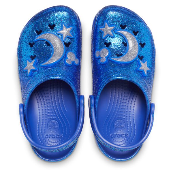Mickey Mouse Clogs for Adults by Crocs – Wishes Come True Blue: You'll be the definitive twinkle toes in these glittering Crocs. Part of the Disney Parks Wishes Come True Blue Collection, they feature Crocs' signature design with a sparkling silver crescent moon, stars, and Mickey icon so you'll feel glamorous every step of the way. $59.99