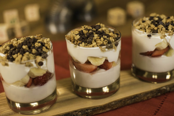 The Banana Split Yogurt Parfait will include layers of banana-vanilla Greek yogurt, fresh bananas, strawberries and pineapple topped with granola and chocolate chips. Photo credits (C) Disney Enterprises, Inc. All Rights Reserved