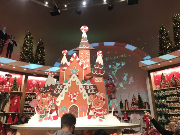 A giant gingerbread house is front and center.
