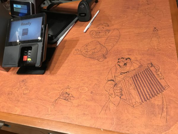 Some animators even drew on their desks, which are now used for the checkout counters!