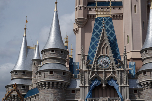 This is not a Photoshop trick - Disney uses a silver primer under the blue on Cinderella Castle to make the blue really pop.